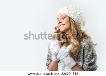 closeup portrait of attractive caucasian smiling woman brunette isolated on white studio shot lips toothy smile face hair head and shoulders winter christmas - stock photo