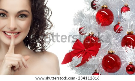 closeup portrait of attractive  caucasian smiling woman brunette isolated on white studio shot lips toothy smile face hair head and shoulders looking at camera tooth secret christmas tree new year - stock photo