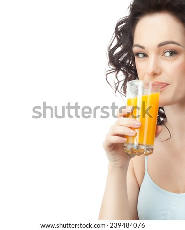 closeup portrait of attractive  caucasian smiling woman brunette isolated on white studio shot lips face hair head and shoulders looking at camera drinking orange juice - stock photo