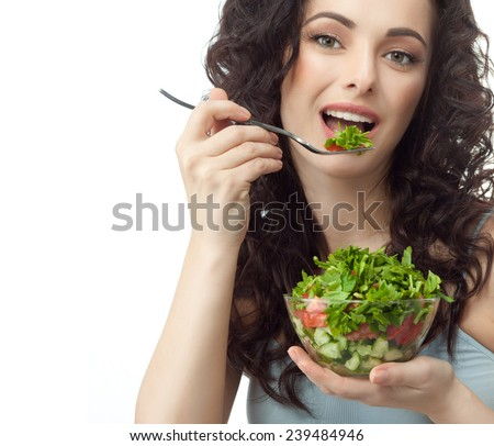 closeup portrait of attractive  caucasian smiling woman brunette isolated on white studio shot lips toothy smile face hair head and shoulders looking at camera eating salad - stock photo
