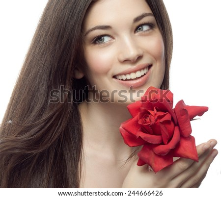 closeup portrait of attractive  caucasian smiling woman brunette isolated on white studio shot lips toothy smile face hair head and shoulders  tooth red rose flower - stock photo