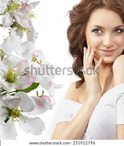 closeup portrait of attractive  caucasian smiling woman brunette isolated on white studio shot lips smile face hair head and shoulders skin spring flowers - stock photo