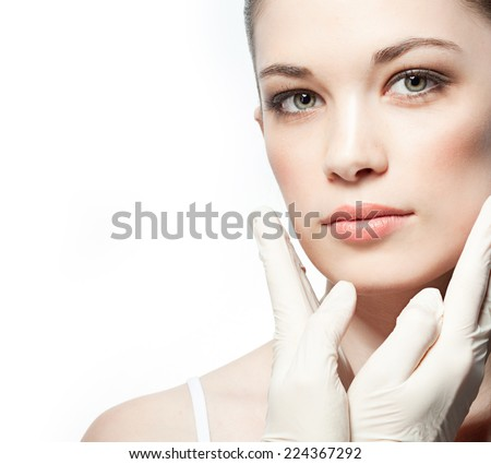 closeup portrait of attractive  caucasian  woman brunette isolated on white studio shot lips face hair head and shoulders looking at camera gloves therapy