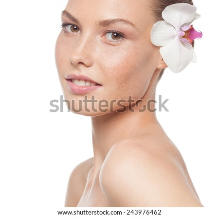 closeup portrait of attractive  caucasian woman brunette isolated on white studio shot lips face head and shoulders looking at camera flower - stock photo