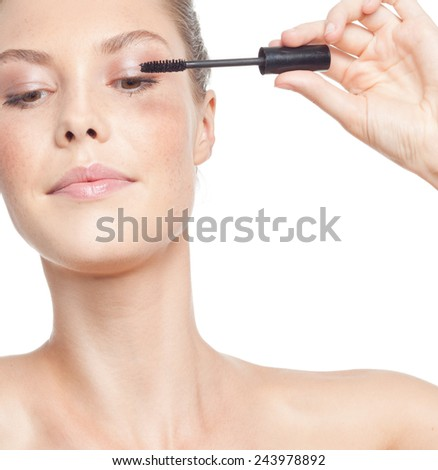 closeup portrait of attractive  caucasian woman brunette isolated on white studio shot lips  face head and shoulders makeup applying mascara eyes - stock photo