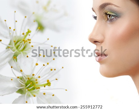 closeup portrait of attractive  caucasian  woman brunette isolated on white studio shot lips face skin makeup hair head  spring flowers - stock photo