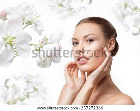 closeup portrait of attractive  caucasian  woman brunette isolated on white studio shot lips  face head and shoulders looking at camera spring flowers - stock photo