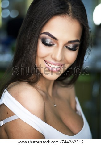Closeup portrait of attractive caucasian woman brunette with beautiful makeup  lips face