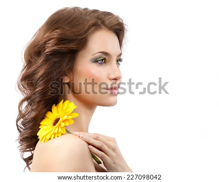 closeup portrait of attractive  caucasian young woman brunette isolated on white studio shot lips face skin hair head and shoulders makeup flower yellow spring summer - stock photo