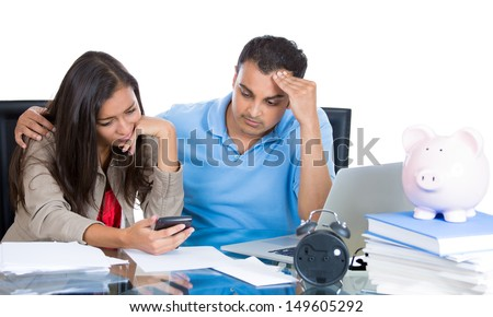 Closeup portrait of attractive couple, man and woman, looking distressed from financial problems and mounting bills, isolated on white background - stock photo