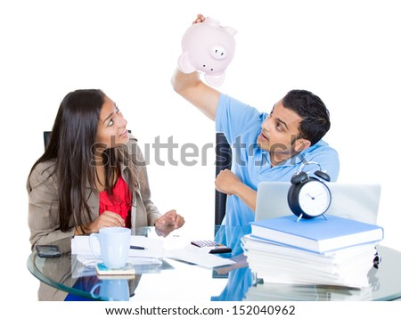 Closeup portrait of attractive couple, man and woman, trying to squeeze out every last cent from piggy bank, distressed from financial problems and mounting bills, isolated on white background - stock photo