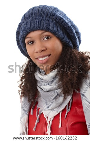 Closeup portrait of attractive ethnic woman in knitted hat, smiling. - stock photo