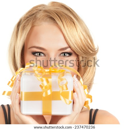 Closeup portrait of attractive female with little gift box in hands isolated on white background, Christmas holidays concept - stock photo
