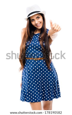 Closeup portrait of attractive Indian woman giving thumbs up sign - stock photo
