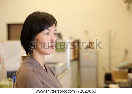 Closeup portrait of attractive mature business woman of Asian in office. - stock photo