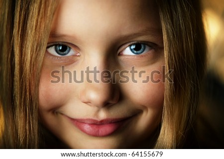Closeup portrait of attractive smiling little girl. Shallow DOF - stock photo