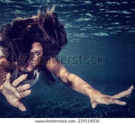 Closeup portrait of attractive woman underwater, active sportive female swimming in transparent sea, healthy lifestyle, travel and tourism concept  - stock photo