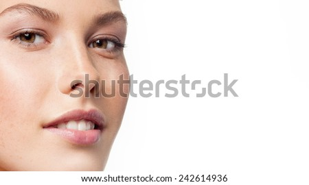 closeup portrait of attractive young caucasian woman brunette isolated on white studio shot lips face  head and shoulders looking at camera tooth - stock photo