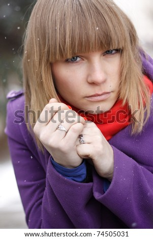 Closeup portrait of attractive young woman in winter - stock photo