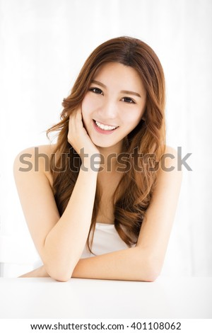Closeup portrait of  attractive young woman smiling - stock photo