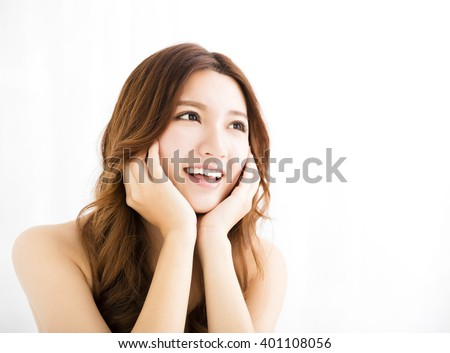 Closeup portrait of  attractive young woman smiling and looking - stock photo