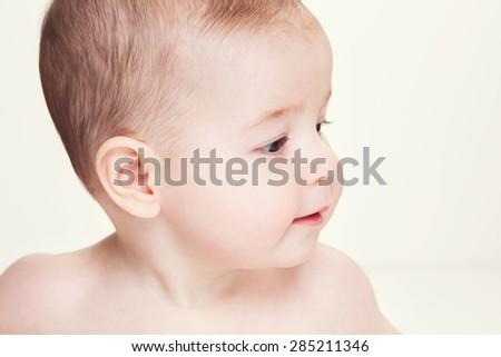 Closeup portrait of beautiful baby - stock photo