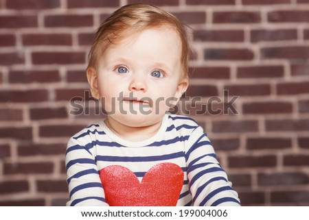 closeup portrait of beautiful baby girl , studio shoot - stock photo