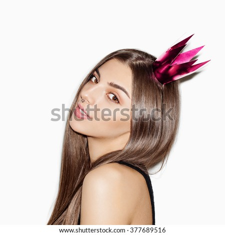 Closeup portrait of beautiful brunette girl with bright make up and long hair. Posing on white background, not isolated  - stock photo