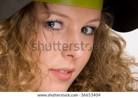 Closeup portrait of beautiful curly girl in welder mask