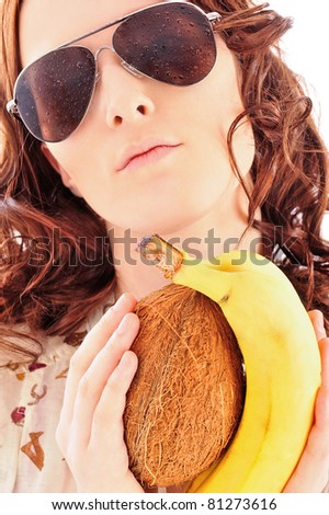 Closeup portrait of beautiful fashion woman wearing sunglasses over a white background holding fruits