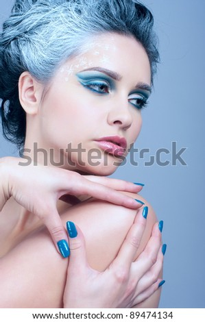 Closeup portrait of beautiful female with winter artistic makeup - stock photo