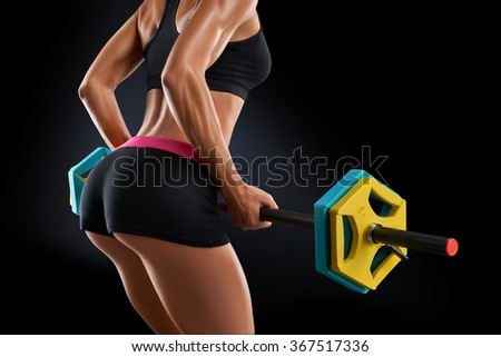 Closeup portrait of beautiful fitness woman training with barbell at gym on black background, isolated. Deadlift barbells workout. - stock photo