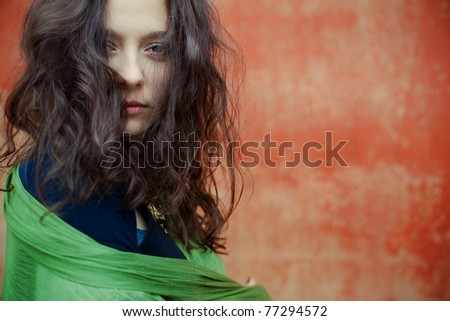 Closeup portrait of beautiful girl-hippie on the street - stock photo