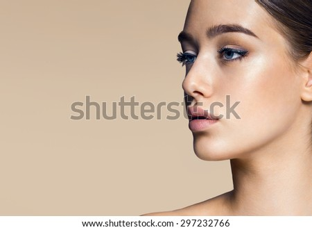 Closeup portrait of beautiful girls face, beauty woman flawless face skin, professional make-up - stock photo
