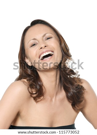 Closeup portrait of beautiful happy Asian woman laughing in studio isolated on white background - stock photo