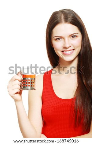 Closeup portrait of beautiful happy young woman drinking tea - stock photo