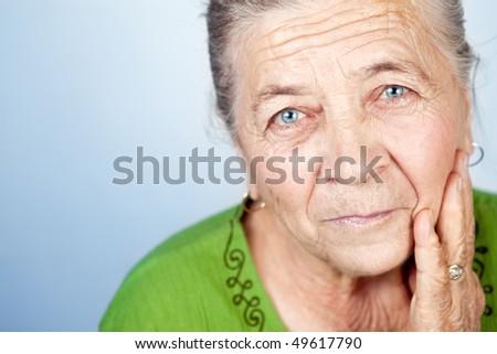 Closeup Portrait of Beautiful Old Senior Woman - stock photo