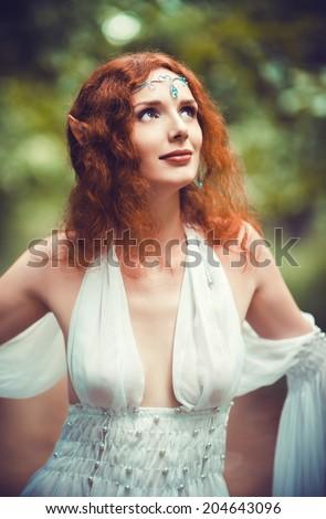 Closeup portrait of beautiful redhead elf woman  - stock photo