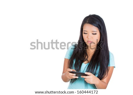 Closeup portrait of beautiful serious woman texting or watching something on her mobile phone  - isolated on a white background with copy space - stock photo