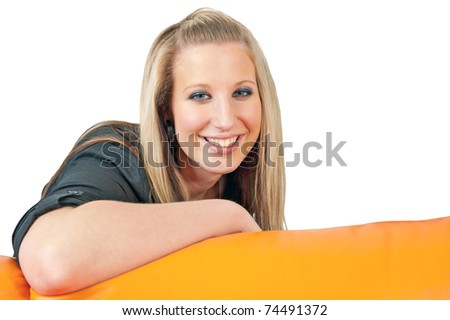 Closeup portrait of beautiful smiling young woman posing in living room - stock photo