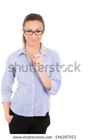 Closeup portrait of beautiful student/businesswoman with glasses pointing to copy space, isolated on white background - stock photo