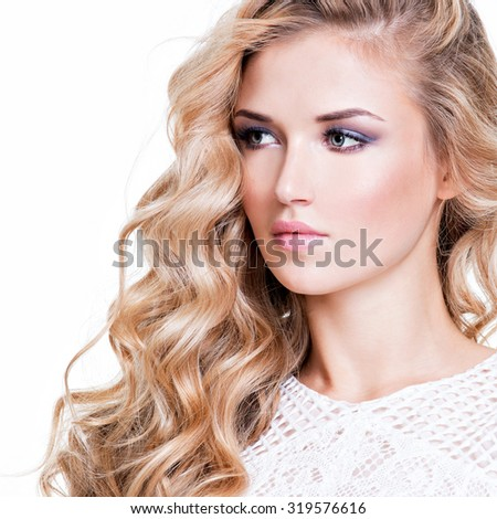 Closeup portrait of beautiful woman with  blond  hairs looking at camera - isolated on white. - stock photo