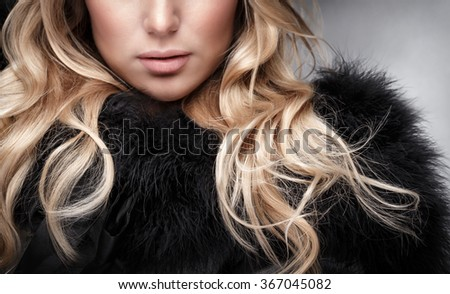 Closeup portrait of beautiful woman with blonde curly hair, face part, glamour fashionable look, luxury beauty salon - stock photo