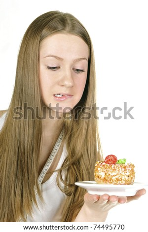 Closeup portrait of beautiful woman with cake - isolated