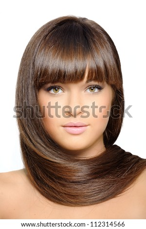 Closeup portrait of beautiful woman with straight long hair over white