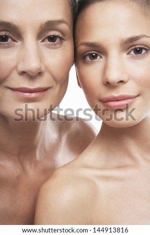 Closeup portrait of beautiful women of different ages on white background - stock photo