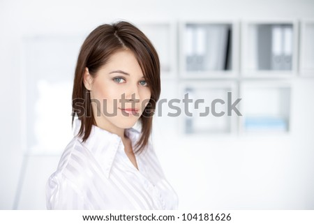 Closeup portrait of beautiful young business woman at office - stock photo