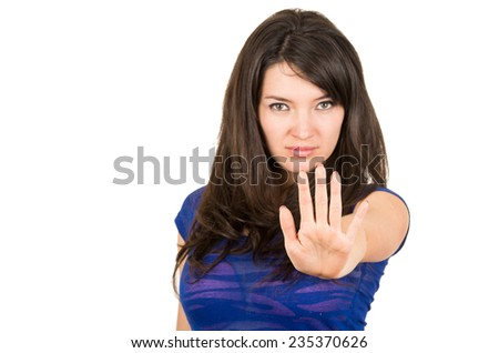 closeup portrait of beautiful young girl posing with hand in front gesturing stop isolated on white