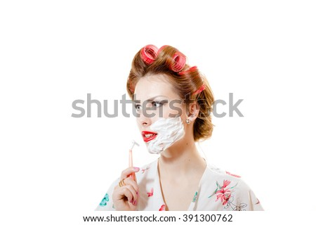 closeup portrait of beautiful young pinup woman attractive girl shaving face and looking at camera isolated on white background