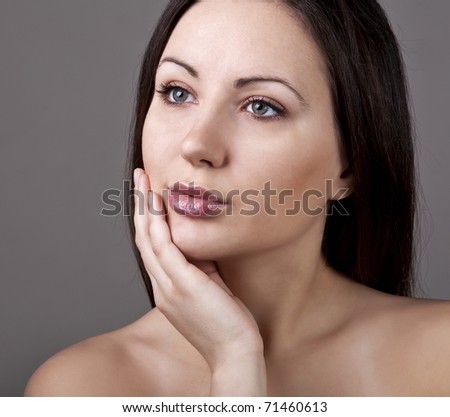 Closeup portrait of beautiful young woman - stock photo